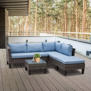 Conjunto de vime ao ar livre com almofadas inclui sofás mesa de café e pufe